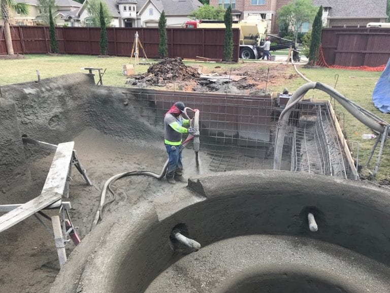 man constructing pool