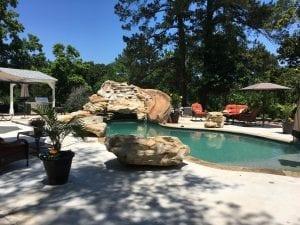 custom pool with waterfall with slide