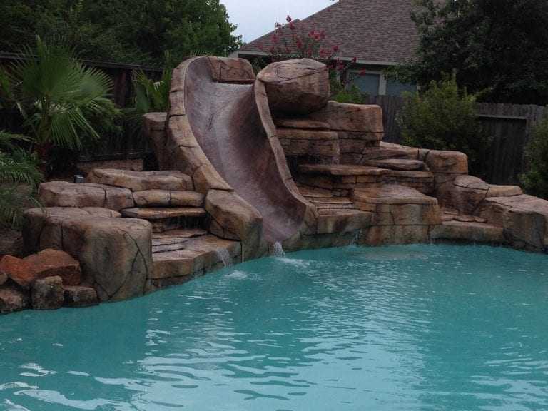 custom pool with waterfall with slide