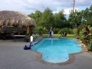 custom pool with patio cover, pergola