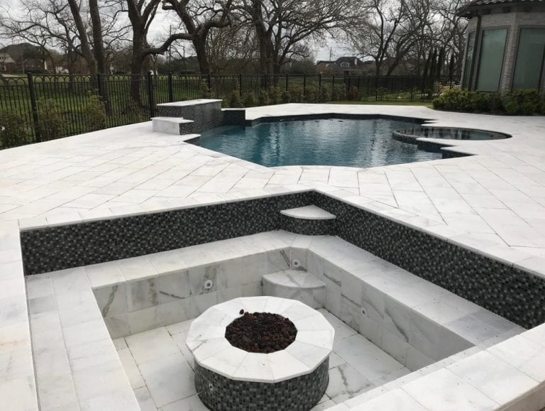custom pool with custom fire pit